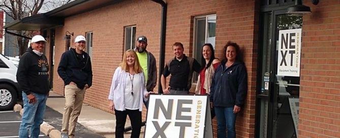 Next Gen Owner Terri Olson and team at training center
